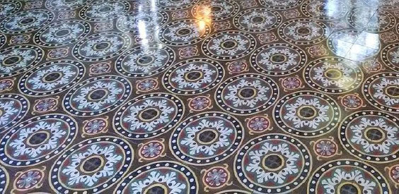 A beautiful and shiny tarrazoo floor that has been cleaned and restored